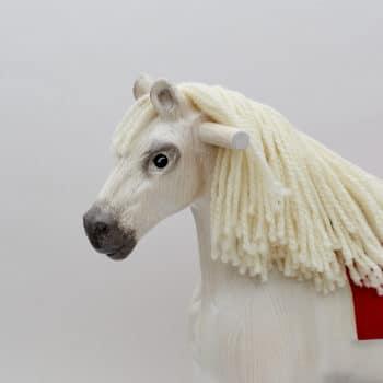 Detail hlavy houpacího koně Čenda 39 bělouše